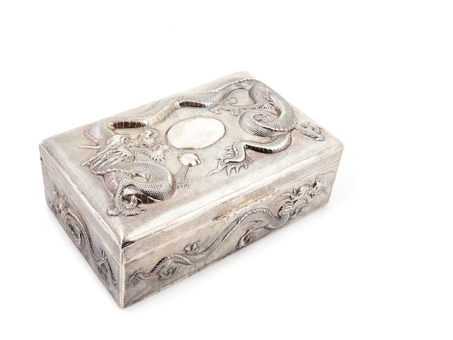 A Chinese Export silver humidor, decorated with dragons, probably Canton