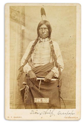 LAKOTA—LOW DOG. c.1847-1894. Albumen print cabinet card, three-quarters length portrait of Oglala Lakota chief Low Dog