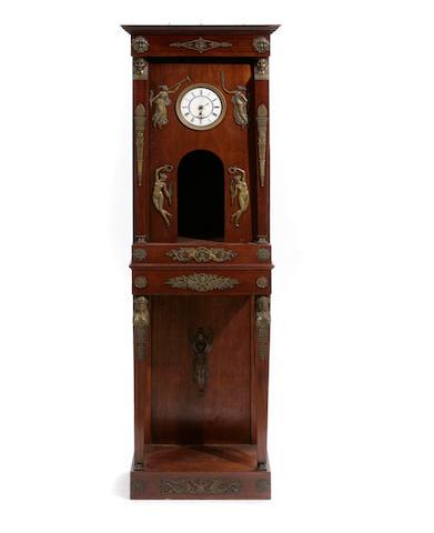 An Empire style gilt bronze mounted mahogany clock