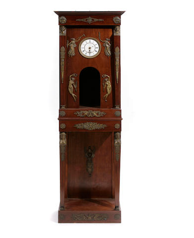 An Empire style gilt bronze mounted mahogany clock