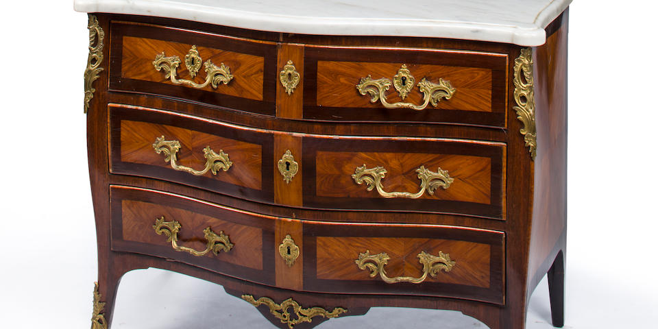 A Louis XV gilt bronze mounted tulipwood and amaranth commode with white marble top mid 18th century and later
