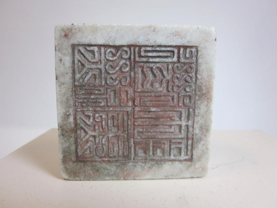 A group of seven large stone seals