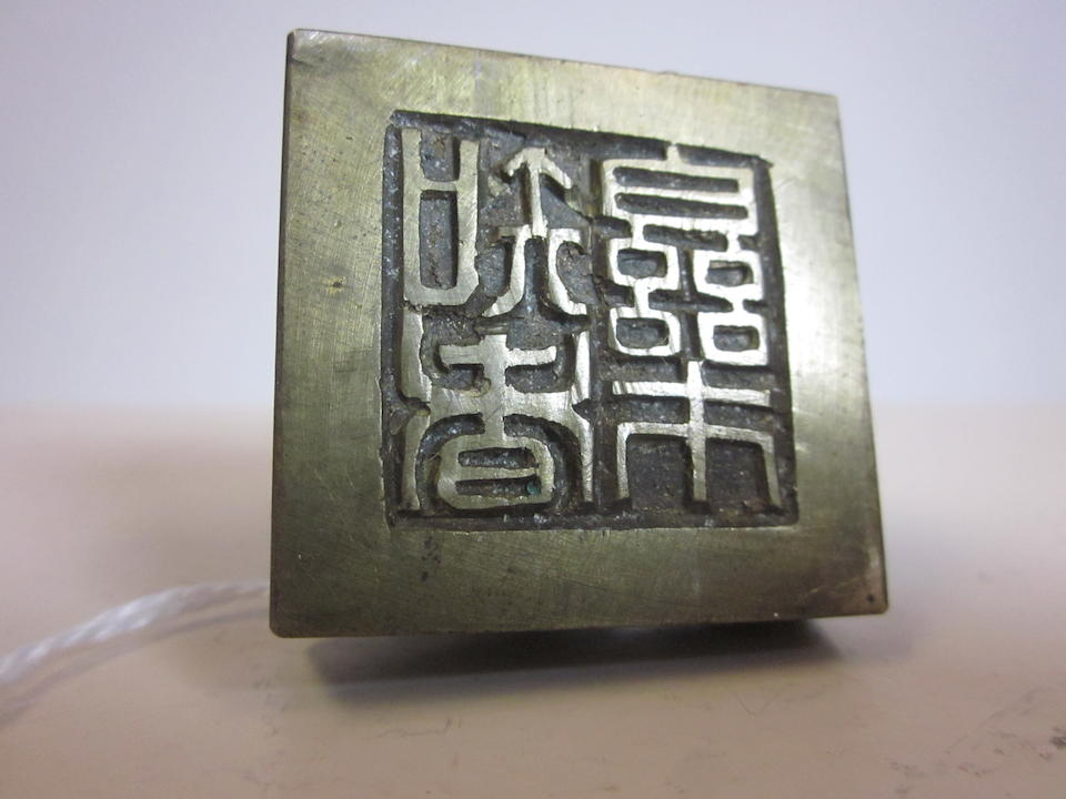 A group of twelve small metal seals