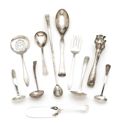 An assembled group of American  hammered sterling silver  Arts & Crafts serving flatware by various makers, early 20th century