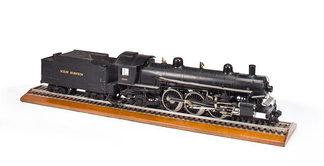 A well-engineered model of a New Haven Railroad 4-6-2 Pacific locomotive and tender<BR />