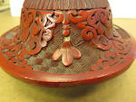 A carved cinnabar lacquer covered jar on stand Late 19th century