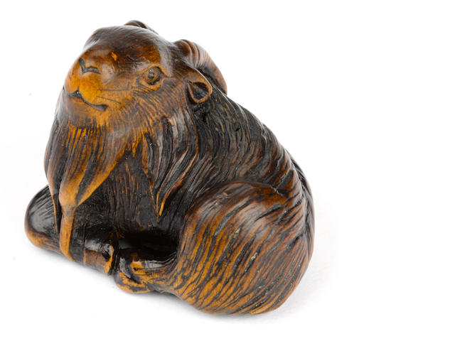 A wood netsuke of a recumbent goat By Masamichi, late Edo/early Meiji (19th century)