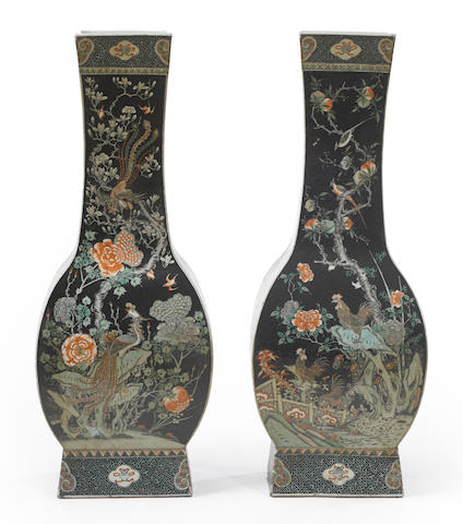 A pair of massive famille noire enameled baluster vases 20th century
