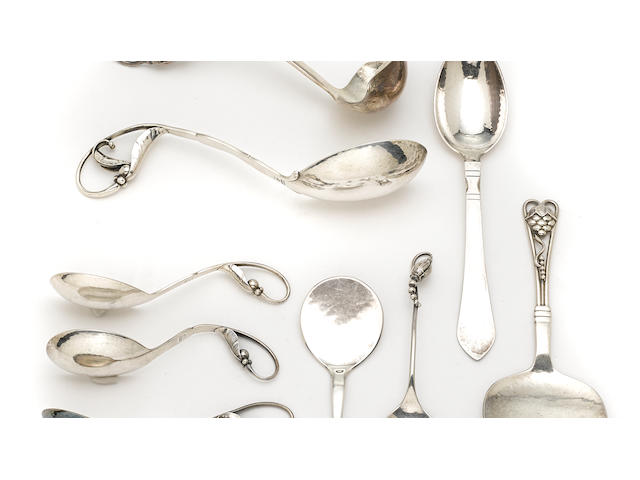 An assembled group of seven Danish  sterling silver  ornamental servers by Georg Jensen Silversmithy, Copenhagen, 1910 - post 1945