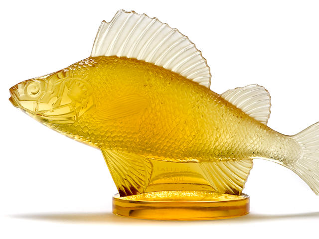 A fine 'Perche' mascot in amber glass by René Lalique, French, 1929,