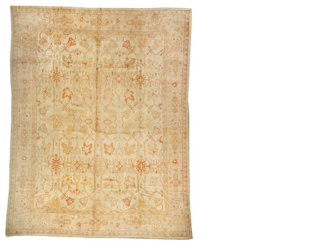An Oushak carpet  West Anatolia size approximately 13ft. x 16ft. 3in.