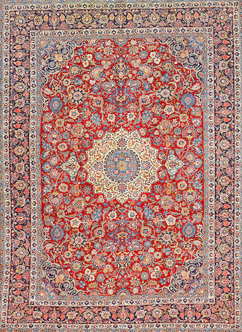 A Kashan carpet  Central Persia size approximately 8ft. 8in. x 11ft. 11in.
