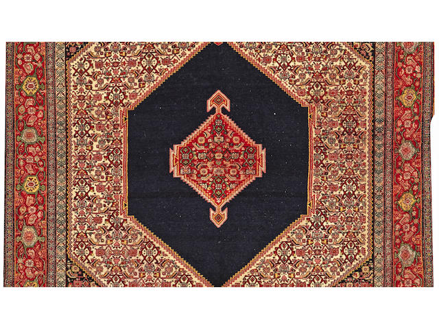 A Senneh Haft Rang rug Central Persia size approximately 4ft. 5in. x 7ft.