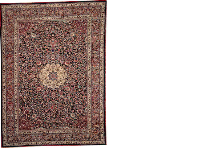 A Meshed Emoghli carpet  Northeast Persia size approximately 9ft. 11in. x 13ft. 5in.