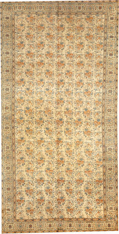 A Tabriz long carpet  Northwest Persia size approximately 7ft. 4in. x 14ft. 6in.