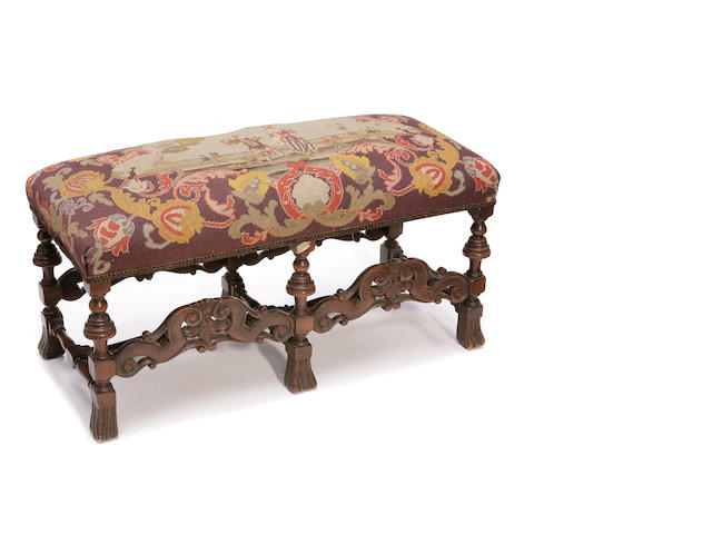 A Continental Baroque style needlework upholstered walnut bench