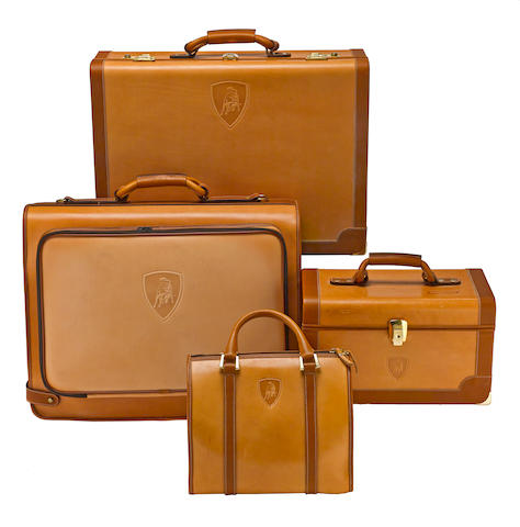 A Lamborghini Diablo suite of tan leather luggage,