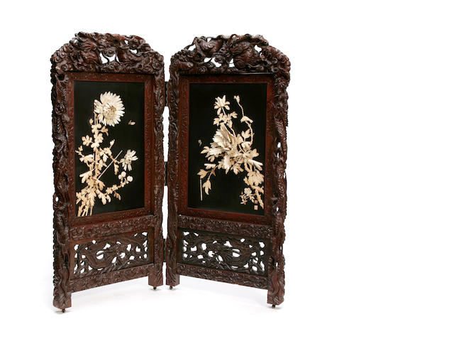 A Japanese carved hardwood and bone two panel screen
