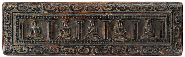 A Wood Manuscript Cover with the Five Tathagathas Tibet, 12th-14th century