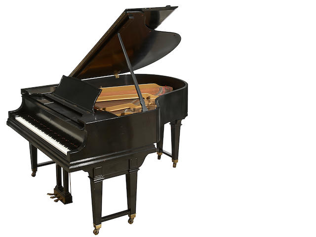A Steinway ebonized baby grand piano
