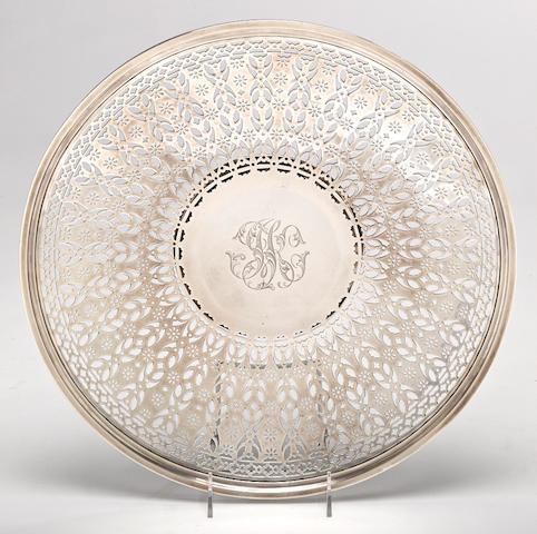 An American sterling silver circular reticulated footed cake stand by Meriden Britannia Co., Meriden, CT; retailed by Theodore B. Starr, New York, NY, first quarter 20th century