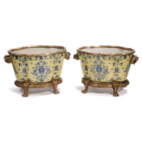 A pair of Continental gilt bronze mounted earthenware jardinéres