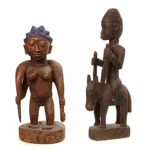 A Yoruba standing female with snake
