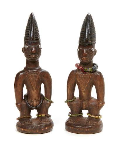 A pair of Yoruba Ibeji twins