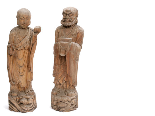 A pair of Chinese carved wood figures