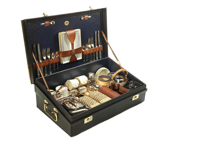 A fine specially commissioned foot-rest picnic set for four persons by Mawsons, Swan & Morgan of Newcastle, circa 1911, formerly the property of Brigadier General Hubert Horatio Shirley Morant,