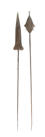 Two large African prestige spears and a large iron currancy