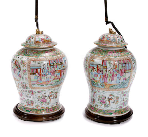 A pair of Chinese export famille rose porcelain covered ginger jars