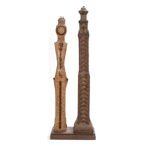 A group of two mounted iron and stone South Pacific Islands style door posts