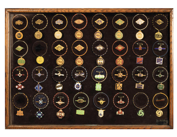 A framed display of Bill Boddy's personal collection of enamel BARC Brooklands member's and guest badges, 1907-1941,