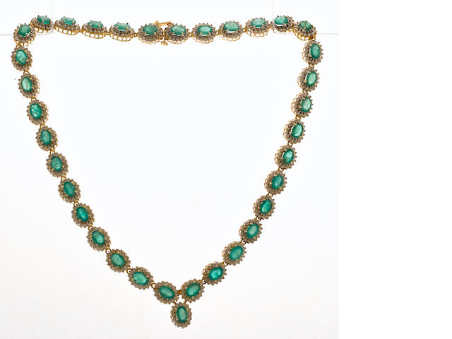 An emerald, diamond and 14k bicolor gold necklace