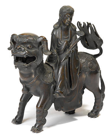 A cast bronze censer in the form of Manjusri on a lion Qing dynasty, 18th/19th century