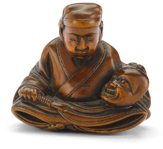 A wood netsuke of a mask carver By Masayuki, Meiji period (late 19th century)