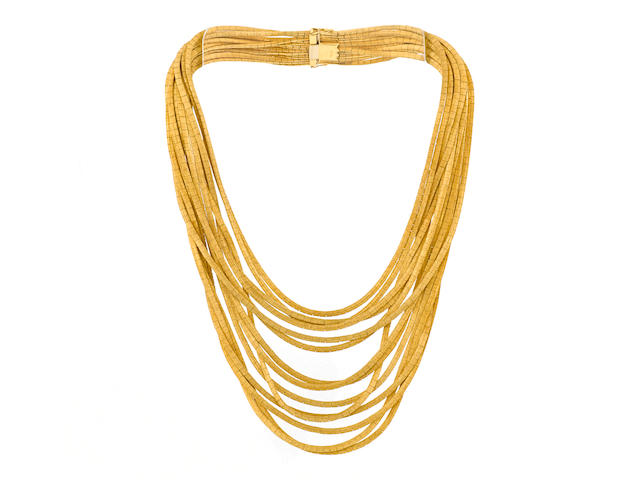 An eighteen karat gold multi-strand bib necklace