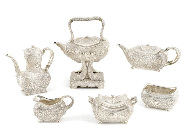 An American  sterling silver  Aesthetic Movement foliate-decorated six-piece coffee and tea service  by Tiffany & Co., New York, NY, circa 1873-1891
