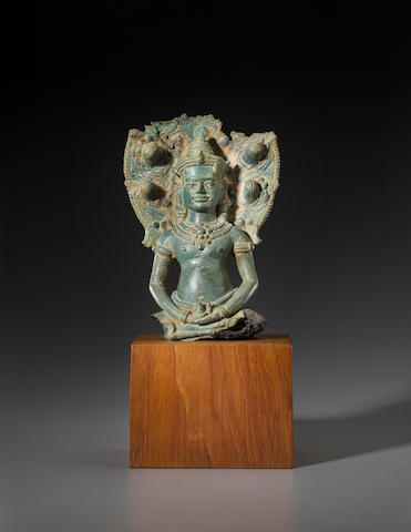 A copper alloy bust of Naga-enthroned Buddha Cambodia, Angkor Wat period, 11th/12th century