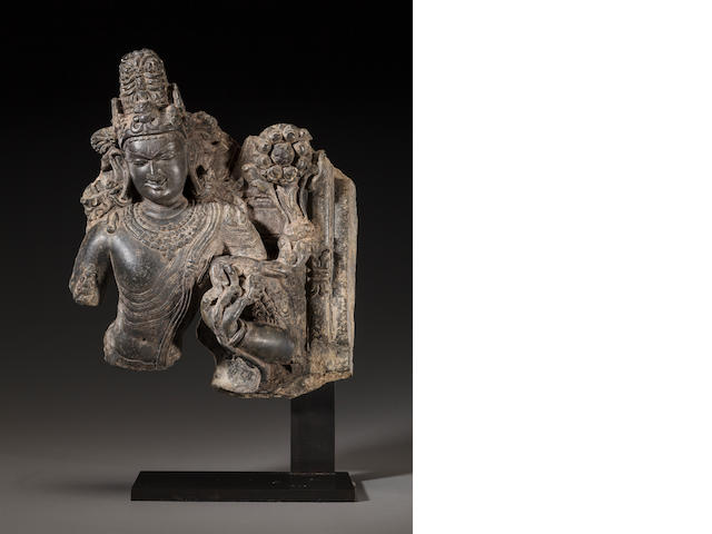 A black stone bust of Padmapani Northeast India, Pala/Sena period, 12th century