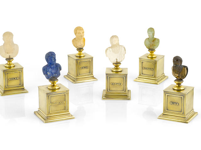 A set of seven George IV  sterling silver-gilt-mounted specimen hardstone  busts of the Seven Sages  by John Linnit, London,  1825