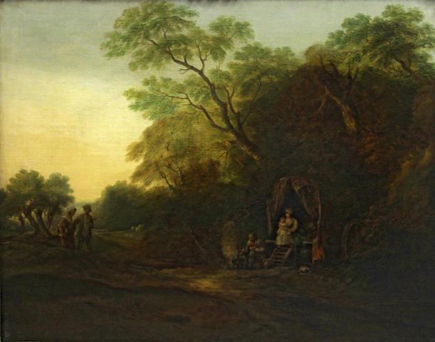 Follower of Thomas Gainsborough, R.A. (Sudbury 1727-1788 London) A gypsy encampment 30 x 37 3/4in