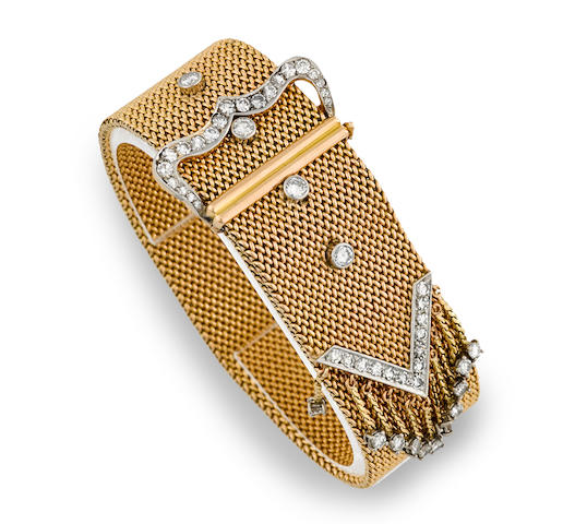 A diamond and platinum-topped fourteen karat gold buckle bracelet
