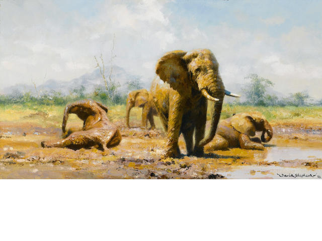 David Shepherd, O.B.E. (British, born 1931) Elephants at a watering hole 9 x 16in (22.8 x 40.7cm)