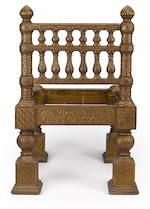 A pair of chased brass overlaid teak side chairs<BR />designed by Lockwood de Forest (1850-1932)<BR />made in Ahmadebad, India, 1881-1882