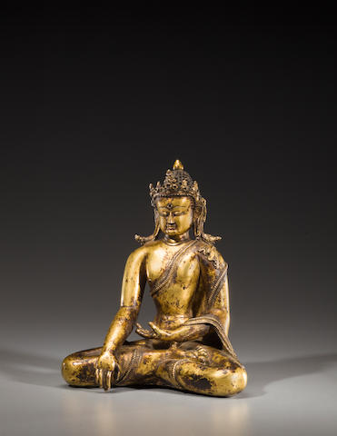 A gilt copper alloy figure of Akshobhya Nepal or Tibet, 14th century