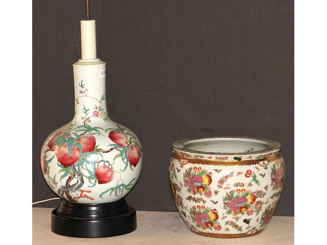 A pair of famille rose enameled stick-neck vases with Nine Peaches decoration Hongxian marks, Republic period