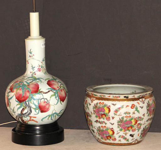 A pair of famille rose enameled stick-neck vases with Nine Peaches decoration Hongxian marks