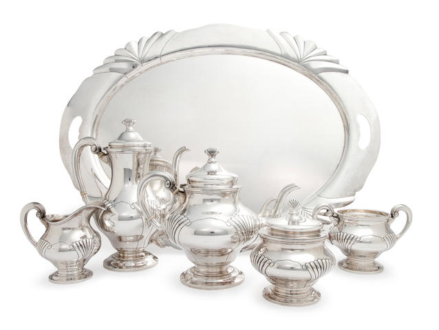An American sterling silver five-piece tea and coffee service with matching oval two-handled tray and water pitcher by Tuttle Silversmiths, Boston, circa 1945-53